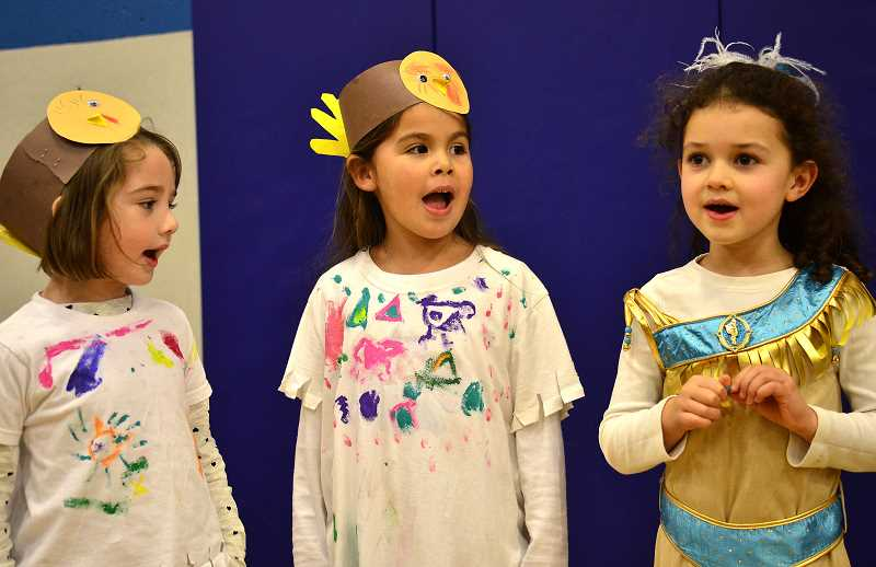 REVIEW PHOTO: VERN UYETAKE - Hallinan Elementary School students Lillian Bradley (from left), Addison Sanchez and Sophia Gardner dress for a Thanksgiving feast and performance.
