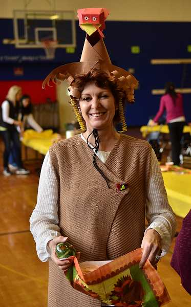 REVIEW PHOTO: VERN UYETAKE - Lake Grove teacher's assistant Maggie Jank dons some festive garb.