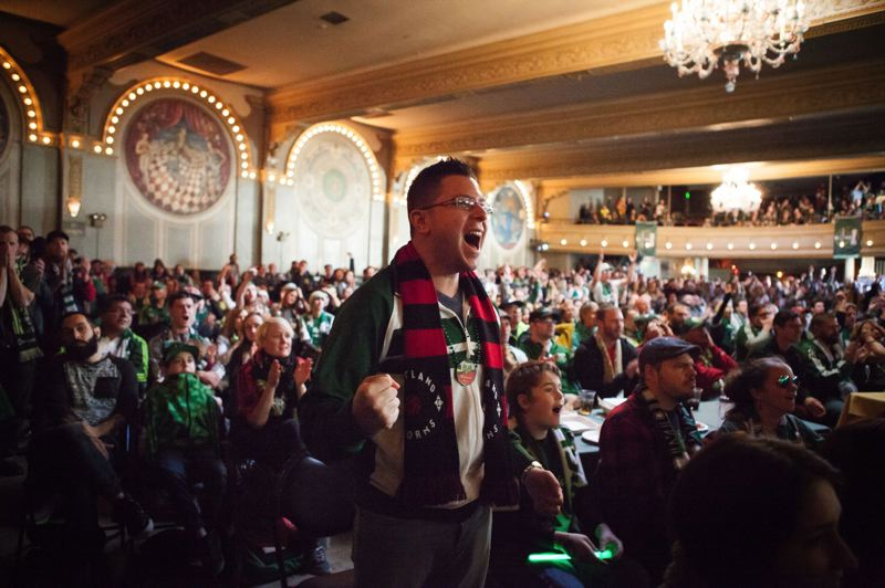 TRIBUNE PHOTO: ADAM WICKHAM - Timbers fan Gabriel Anaya cheers with the crowd at Portland's Crystal Ballroom during Sunday's match against Dallas. The ballroom was packed with soccer fans who watched the match on a large screen.