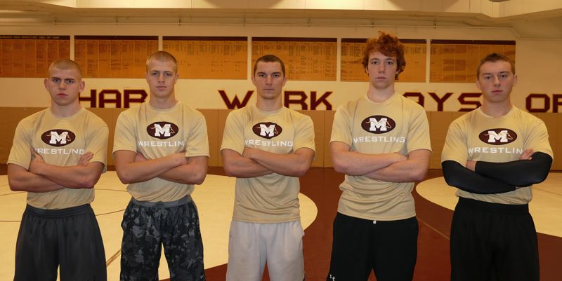 JOHN DENNY - Milwaukies wrestling program has one of its biggest turnouts in years and Milwaukies five team captains believe that talent, numbers and hard work will translate into wins on the mat this winter. Pictured are team captains (left to right): Mikel Bremner, Jon Snyder, River Meyer, Mountain Witzel and Anthony Flynn.