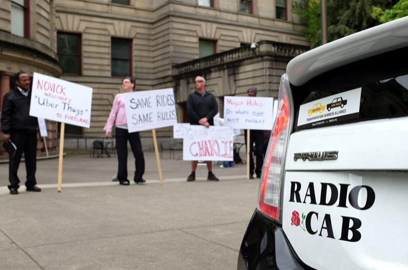 TRIBUNE FILE PHOTO - eTaxi drivers demonstrated outside City Hall ain August s the Portland City Council considers pilot project to allow the entry of Uber and Lyft into the taxi market.