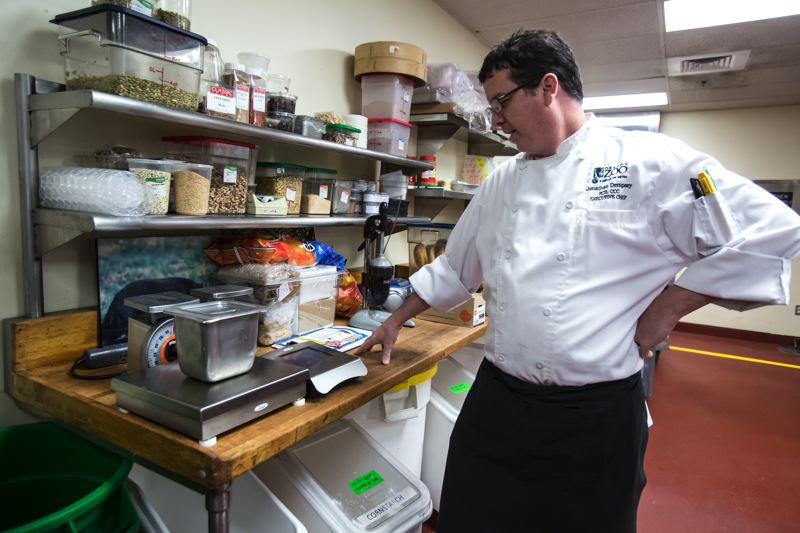 PAMPLIN MEDIA GROUP: JONATHAN HOUSE - Oregon Zoo executive chef Jonathan Dempsey weighs food waste that will be composted.