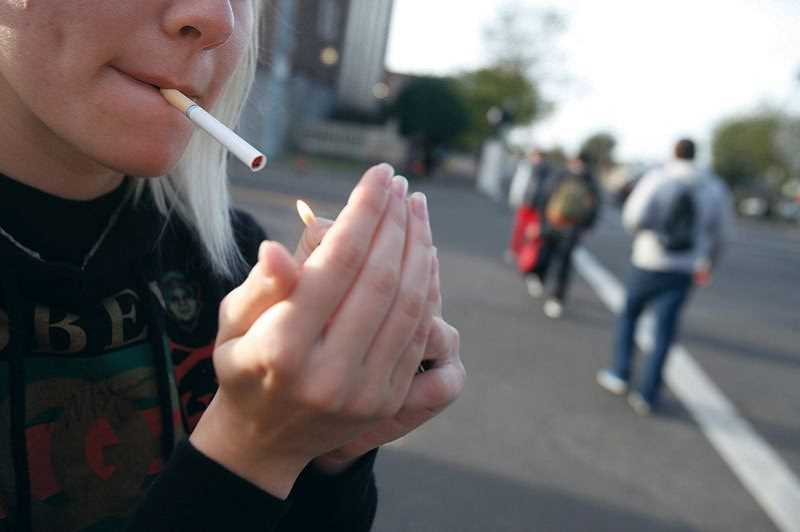 FILE PHOTO - Under a proposed city ordinance, smoking and e-cigarettes would be banned from Tigard public parks.