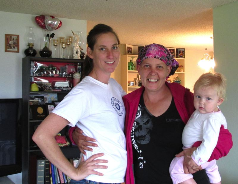 PHOTO COURTESY MICHELLE'S LOVE - Andy McCandless, founder of Michelle's Love, with Angie Van Ortwick and her daughter in 2013. Van Ortwick is one of about 30 people who has been helped by Michelle's Love, a nonprofit organization the helps single mothers going through cancer treatment.