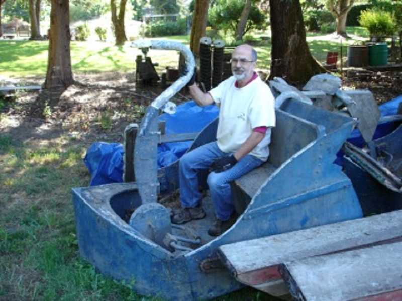 COURTESY OF TUALATIN RIVERKEEPERS - Charlie Stalzer sits in a dilapidated swan boat brought to the Tualatin Riverkeepers' property from John Frederick's farm, where it sat for decades.