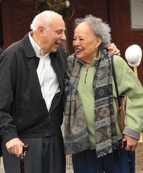 REVIEW PHOTO: VERN UYETAKE - Gene Wizer talks with longtime friend Dee Denton after groundbreaking ceremonies on the Wizer Block in October.