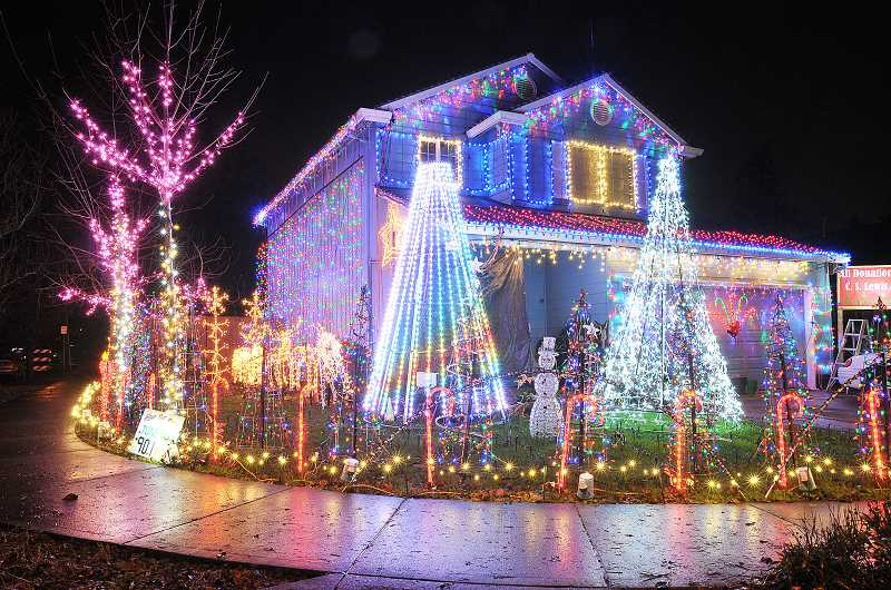 GARY ALLEN - Night lights - Matt Ross has been intricately decorating his family's house at the corner of Lilly Court and Wynooski Road for about four years. His is one of many to appear on the Newberg Public Library's map of light displays citywide, which the city has maintained for the past few Christmas seasons since K'Lyn Hann thought of the idea.