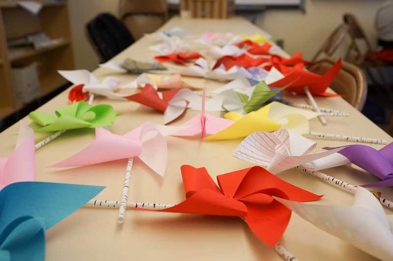 NEWS-TIMES PHOTOS: STEPHANIE HAUGEN - These colorful pinwheels will raise money to help Syrian refugee children.