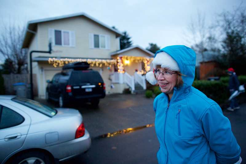 TIMES PHOTO: JAIME VALDEZ - Carolyn Horne, a longtime resident on Southwest Avon Street in Tigard, helped to bring back Christmas Card Lane, a neighborhood Christmas light display that was popular in the 1980s and 1990s.