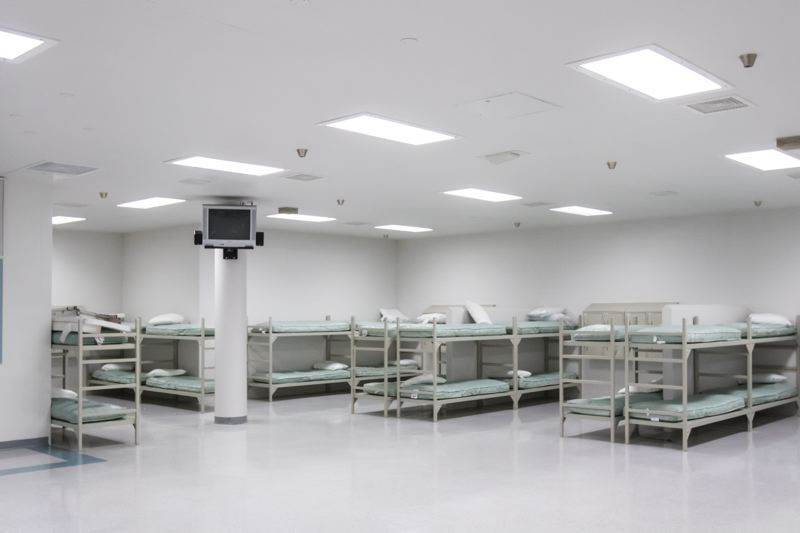 PORTLAND TRIBUNE PHOTO: JONATHAN HOUSE - Unused beds in one of six 50-bed dormitories in the Wapato Corrections Facility. The North Portland building was built for 525 beds.