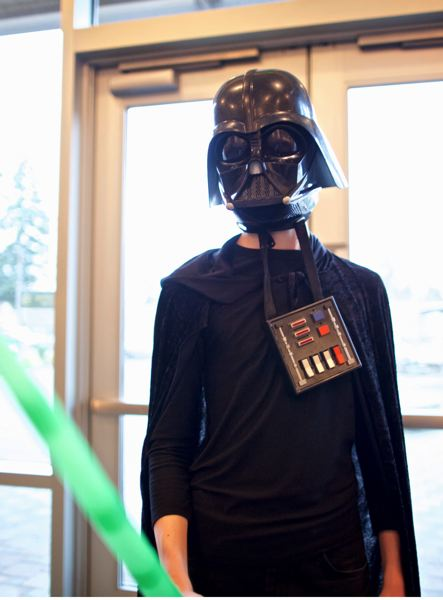 TIMES PHOTO: JAIME VALDEZ - Ben Caron, a freshman at Tualatin High School, dressed as Darth Vader, was one of the winners of a Star Wars 'trivia battle' at the Tualatin Public Library last week.