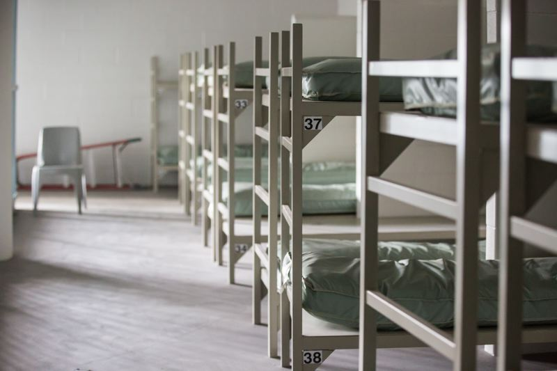 PORTLAND TRIBUNE PHOTO: JONATHAN HOUSE - Some of the 525 empty beds and lockers at the never-opened Wapato Corrections Facility in North Portland. County officials say it is not a viable homeless shelter.