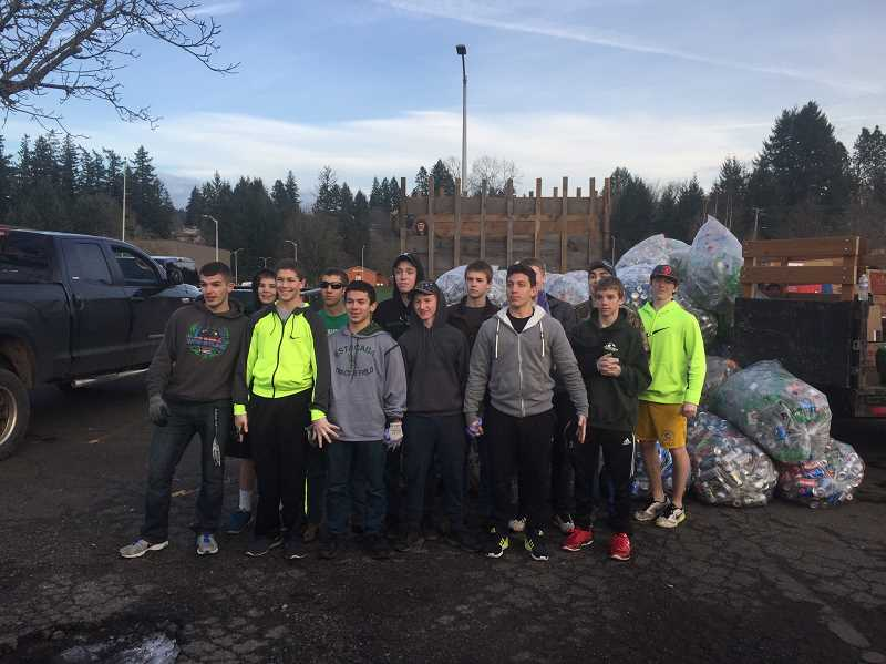 CONTRIBUTED PHOTO: SHARYN MILLER - The Estacada High School wrestling team will host a soda can drive at 10 a.m. Jan. 2 in the high school parking lot. Proceeds will support travel costs for the team.