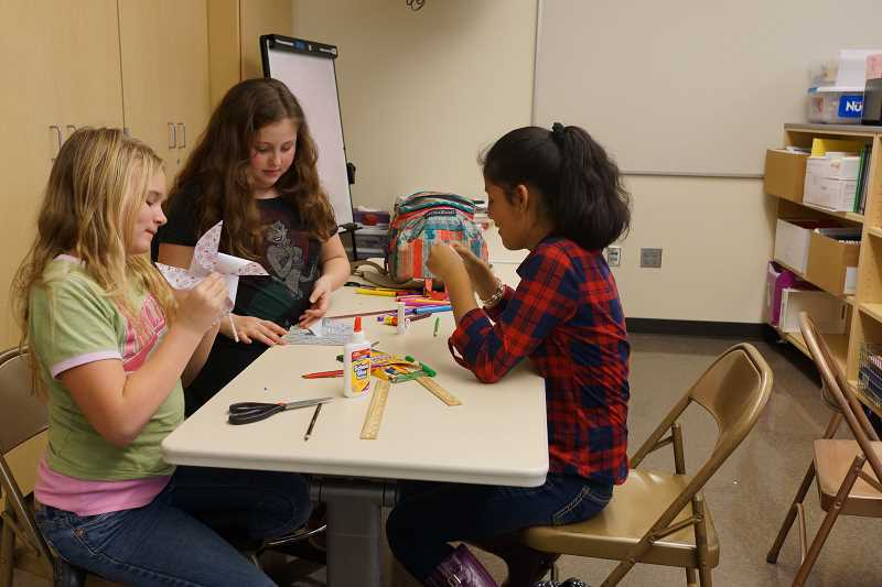 Young women at Tom McCall Upper Elementary School  worked hard on their pinwheels before Christmas break.