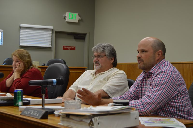 SPOTLIGHT FILE PHOTO - Scappoose city councilors discuss the pros and cons of allowing marijuana businesses in city limits during a workshop earlier this year. The city is slated to vote on whether to initiate a ballot measure to ban all future marijuana businesses in 2016.