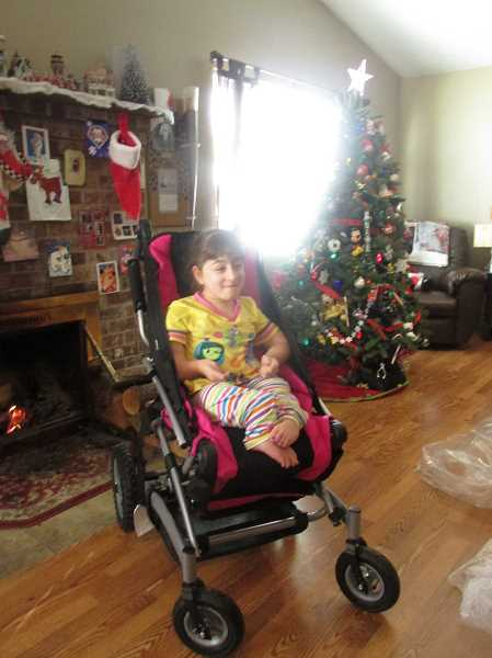 ESTACADA NEWS PHOTO: EMILY LINDSTRAND - Bryten Figgins, 13, has Osteogenesis Imperfecta, or brittle bone disease. Her new custom-made  wheelchair will allow her to more easily participate in activities.