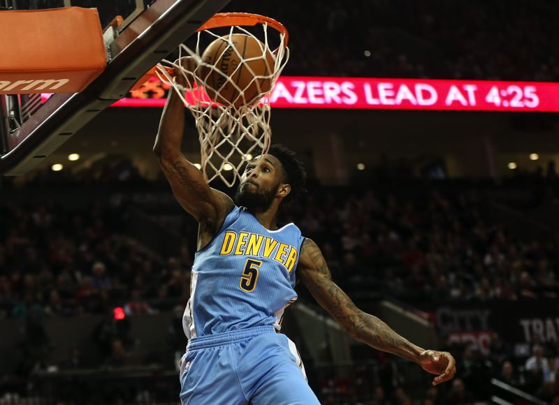 TRIBUNE PHOTO: DAVID BLAIR - Will Barton slams home two of his game-high 31 points Wednesday night at Moda Center, where Barton and the Denver Nuggets lost 110-103 to the Trail Blazers.
