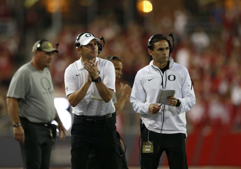 COURTESY: ERIC EVANS - Newly appointed offensive coordinator Matt Lubick (right) came to the Oregon Ducks as kind of an outsider, but he has paid his dues and proved himself on numerous coaching fronts, says coach Mark Helfrich (center).