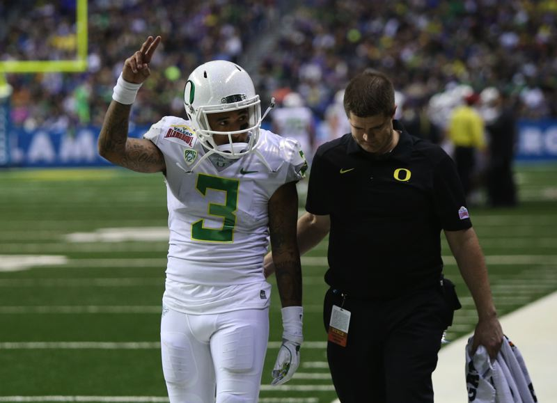 COURTESY: CHRIS PIETSCH/THE REGISTER-GUARD - Oregon's Vernon Adams Jr. leaves the field after being injured in the first half against TCU in the Alamo Bowl.