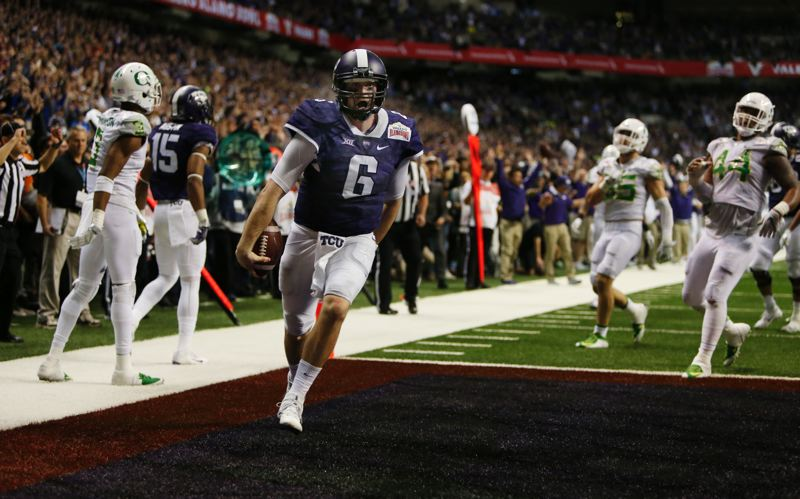 COURTESY: ANDY NELSON/THE REGISTER-GUARD - TCU quarterback Bram Kolhausen celebrates the Horned Frogs' winning touchdown in the third overtime at the Alamo Bowl.