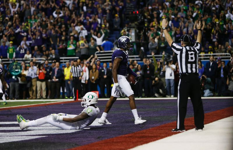 COURTESY: ANDY NELSON/THE REGISTER-GUARD - TCU receiver Emmanuel Porter walks past Oregon's Chris Seisay after scoring in the first OT.