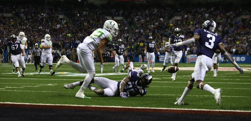 COURTESY: CHRIS PIETSCH/THE REGISTER-GUARD - Oregon's Darren Carrington is unable to make the catch on the final play of the game.