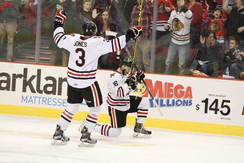 COURTESY: BRYAN HEIM/PORTLAND WINTERHAWKS - Blake Heinrich (right) of the Portland Winterhawks celebrates his first-period goal with teammate Caleb Jones on Saturday night.