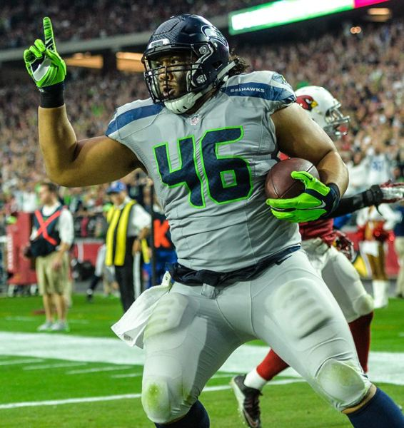 TRIBUNE PHOTO: MICHAEL WORKMAN - Seattle Seahawks fullback Will Tukuafu, from the University of Oregon, scores on a 7-yard touchdown catch, his first reception of the season, in a 36-6 victory Sunday at Arizona.