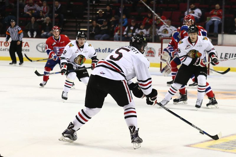 COURTESY: DAYNA FJORD/PORTLAND WINTERHAWKS - Portland Winterhawks defenseman Jack Dougherty looks for an open passing lane against the Spokane Chiefs on Sunday at Moda Center.