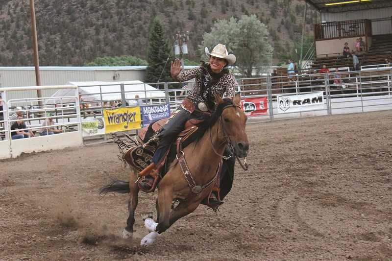 COURTESY PHOTO: JULIE DRESCHER - Julie Drescher, Miss Rodeo Oregon 2015, waves to the crowd at a rodeo in Montana.