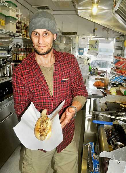 FILE PHOTO - Come-back -- Diva Dogs is working on opening back up as a food truck in Newberg, and a fundraising campaign has launched to assist owner Scott Santrizos in the effort.