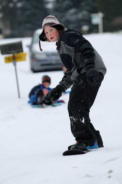 PHOTO COURTESY SARAH MORRIS - Jack Gertenichh of West Linn tries snowboarding West Linn.