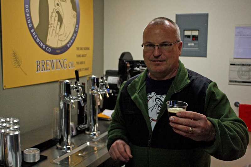 POST PHOTO: KYLIE WRAY - John Griffith, owner of Boring Brewing Co., offers a taste of his Hot Scotch brew, his wifes personal favorite.