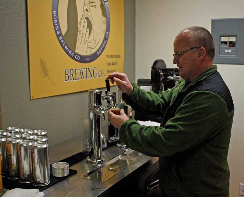 POST PHOTO: KYLIE WRAY - John Griffith, owner of Boring Brewing Co., pours a taster from on tap at his businesss new taproom.