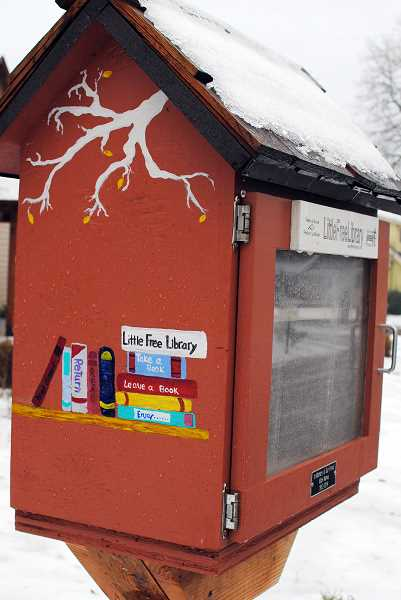 NEWS-TIMES PHOTO: STEPHANIE HAUGEN - The Dehner family doesnt just give away books in its Little Free Library--it gets new ones donated by strangers.