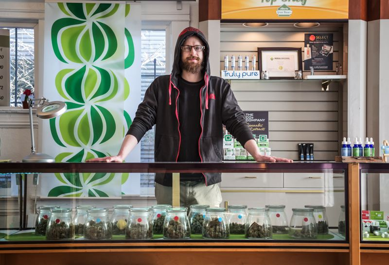 TRIBUNE PHOTO: JONATHAN HOUSE - Michael Smith of the Alberta Green House doesn't believe new taxes on marijuana starting Jan. 4 will affect sales much, but worries the money won't go to government services promised.