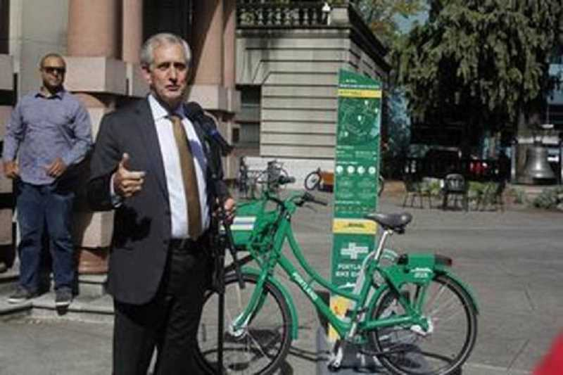 COURTESY: PORTLAND BUREAU OF TRANSPORATION  - Mayor Charlie Hales stands with a smart bike in September just after City Council passed the Bike Share ordinance. PBOT is announcing a significant new program partnership with Nike.