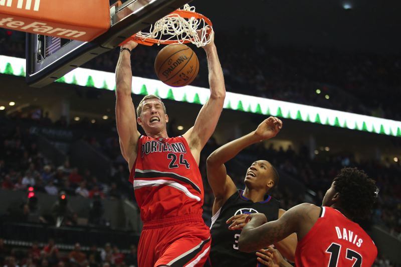 TRIBUNE PHOTO: JAIME VALDEZ - Trail Blazers center Mason Plumlee dunks inside C.J. Wilcox of the Los Angeles Clippers.
