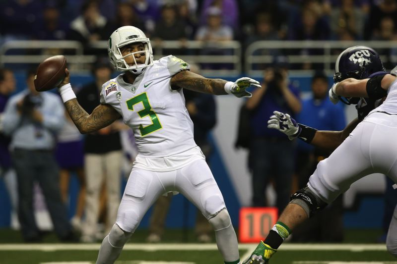 COURTESY: CHRIS PIETSCH/THE REGISTER-GUARD - Oregon Ducks senior quarterback Vernon Adams Jr. prepares to launch a long pass during the first half of the Alamo Bowl against TCU.