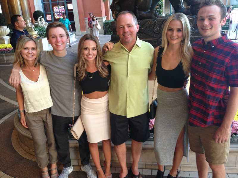 SUBMITTED PHOTO - The Bushnell family of West Linn -- 'The Bachelor' candidate Lauren Bushnell is second from right -- are all getting to see the footage of the previously filmed program as episodes are unveiled this month and next.