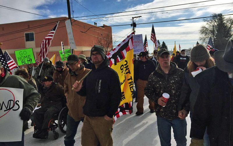 KOIN NEWS PHOTO - Protesters in Burns march Saturday, Jan. 2. On Sunday, armed militants occupied federally owned buildings at the Malheur National Wildlife Refuge in protest of father and son ranchers who were sentenced to return to prison.