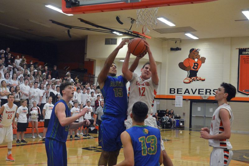 TIMES PHOTO: MATT SINGLEDECKER - Aloha's Trey Hornbuckle and Beaverton's Hunter Sweet battle for a rebound in the third quarter of the Beavers blowout win on Friday.
