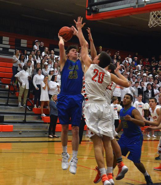 TIMES PHOTO: MATT SINGLEDECKER - Aloha senior power forward Shane Sullivan led the Warriors with a team-high 20 points against Beaverton on Friday.