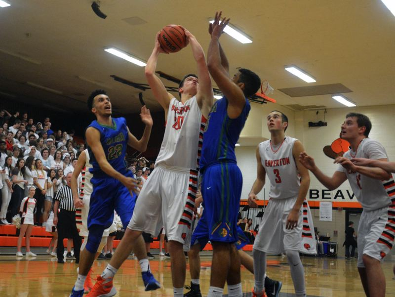 TIMES PHOTO: MATT SINGLEDECKER - Beaverton junior power forward Beau Sheeran powers home a jump hook in the second half of the Beavers victory over Aloha on Friday.