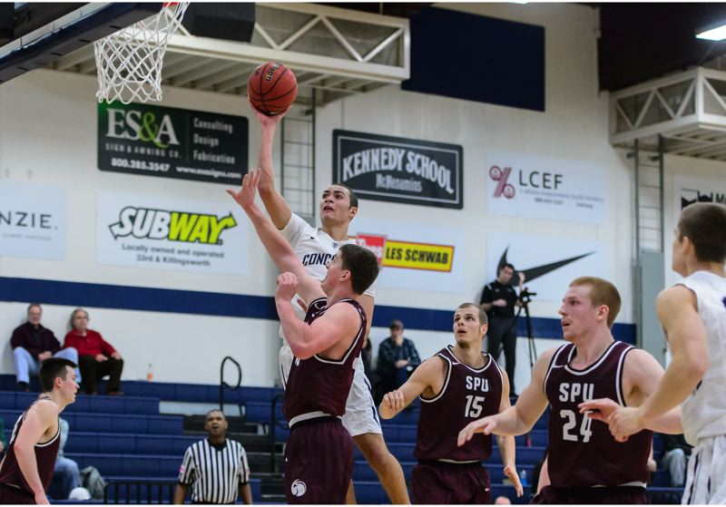 COURTESY: CHRISTOPHER OERTELL - Concordia University's Drew Martin puts up a short jump shot over the Seattle Pacific defense during Saturday night's NCAA Division II game at Concordia.