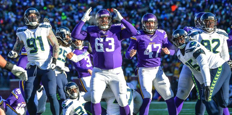 TRIBUNE PHOTO: MICHAEL WORKMAN - Seattle and Minnesota players react as the Vikings' last-minute field goal fails, leaving the Seahawks on top 10-9 in their NFL playoff game Sunday at Minneapolis.