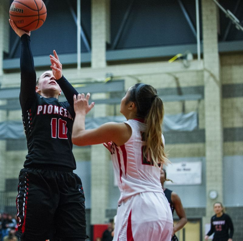 JOHN LARIVIERE - Oregon City senior sharpshooter Cierra Walker (10) used cant-miss shooting from downtown to stake Oregon City to an early 12-4 lead, as the Pioneers routed Clackamas, winning 53-37, in a Friday night game at Clackamas.