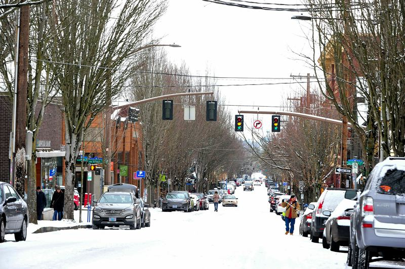 TRIBUNE FILE PHOTO - About 1.5 inches of snow blanketed the Portland area Sunday, Jan. 3, slowing traffic and shutting down city offices. The city's Shawn Rogers opened the Customer Service Center early Monday morning, Jan. 4, so people could reserve park space for their weddings.