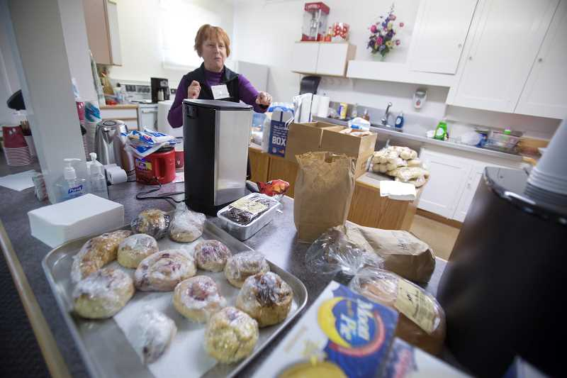 TIMES PHOTO: JONATHAN HOUSE - Just Compassion vice-chair Donna Krauthoefer looks over several donated lunch items. The day center offers a meal and a place to rest from 10 a.m. to 2 p.m., on Thursdays.