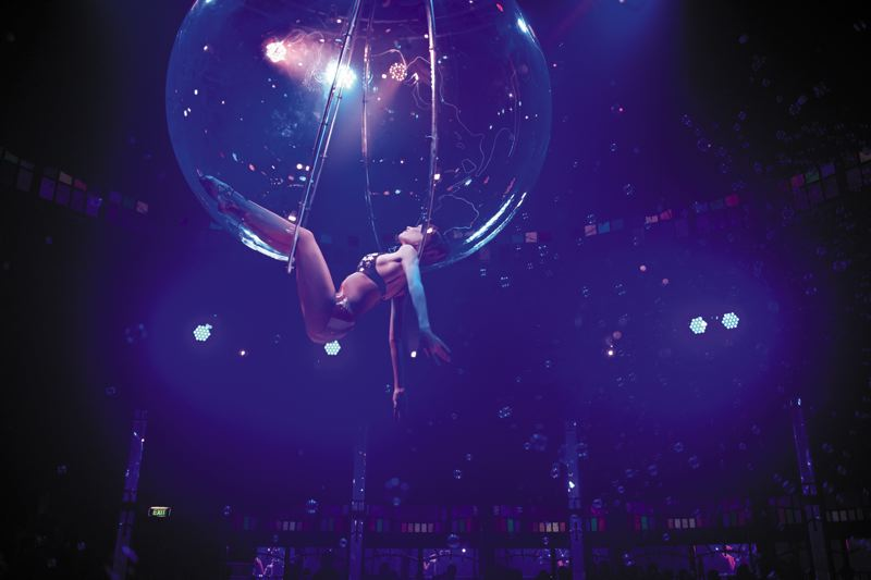 COURTESY PHOTOS: MIKE EMMETT - Spiegelworlds Empire includes acrobat Miss. A. and her hanging bubble and the Gorilla Girls.